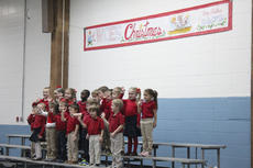 """<div class=""""source"""">Photo by Brandon Mattingly</div><div class=""""image-desc"""">Pre-schoolers wave to their family members in the crowd after singing """"Jingle Bells"""" and """"S-A-N-T-A"""" to start off Thursday's Christmas program.</div><div class=""""buy-pic""""><a href=""""/photo_select/15547"""">Buy this photo</a></div>"""