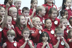 """<div class=""""source"""">Photo by Brandon Mattingly</div><div class=""""image-desc"""">Above, first-graders at Washington County Elementary School sing """"I've Got Christmas."""" The performance was part of last Thursday's Christmas program.</div><div class=""""buy-pic""""><a href=""""/photo_select/15544"""">Buy this photo</a></div>"""