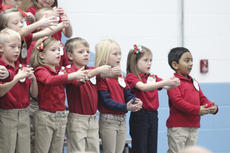 """<div class=""""source"""">Photo by Brandon Mattingly</div><div class=""""image-desc"""">First-graders mimic Santa's jolly tummy during last week's performance.</div><div class=""""buy-pic""""><a href=""""/photo_select/15548"""">Buy this photo</a></div>"""