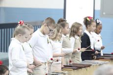"""<div class=""""source"""">Photo by Brandon Mattingly</div><div class=""""image-desc"""">Second-graders show that their musical ability isn't limited to singing.</div><div class=""""buy-pic""""><a href=""""/photo_select/15545"""">Buy this photo</a></div>"""
