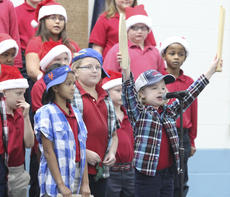 """<div class=""""source"""">Photo by Brandon Mattingly</div><div class=""""image-desc"""">Third-grader Arabella Ross sings her solo in """"Nuttin' for Christmas,"""" as Nastasia Doty waits her turn.</div><div class=""""buy-pic""""><a href=""""/photo_select/15546"""">Buy this photo</a></div>"""