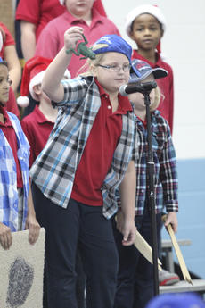 """<div class=""""source"""">Photo by Brandon Mattingly</div><div class=""""image-desc"""">Above, third-grader Emma Mudd takes her turn at the mic. At right, Second-graders show that their musical ability isn't limited to singing.</div><div class=""""buy-pic""""><a href=""""/photo_select/15549"""">Buy this photo</a></div>"""