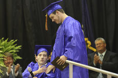 """<div class=""""source""""></div><div class=""""image-desc"""">Brent Young was Washington County High School's first recipient of the Helping Hands award. Young is pictured standing with Charlie McIlvoy, a fellow student and friend who has benefited from Young's willingness to help.</div><div class=""""buy-pic""""><a href=""""/photo_select/16512"""">Buy this photo</a></div>"""