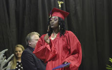 """<div class=""""source"""">Photo by John Overby</div><div class=""""image-desc"""">Jennifer Keene dances across the stage after accepting her diploma.</div><div class=""""buy-pic""""><a href=""""/photo_select/16516"""">Buy this photo</a></div>"""