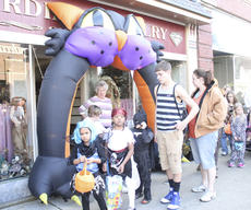 """<div class=""""source"""">Photo by Brandon Mattingly</div><div class=""""image-desc"""">Decorations along Springfield's Main St. included an inflatable black cat outside of Hardin's Jewelry.</div><div class=""""buy-pic""""><a href=""""http://web2.lcni5.com/cgi-bin/c2newbuyphoto.cgi?pub=023&orig=img_2733-1.jpg"""" target=""""_new"""">Buy this photo</a></div>"""