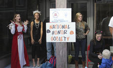 """<div class=""""source"""">Photo by Brandon Mattingly</div><div class=""""image-desc"""">Tthe WCHS National Honor Society, above, gave out candy during downtown hours in Springfield.</div><div class=""""buy-pic""""><a href=""""http://web2.lcni5.com/cgi-bin/c2newbuyphoto.cgi?pub=023&orig=img_2747-1.jpg"""" target=""""_new"""">Buy this photo</a></div>"""