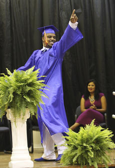 """<div class=""""source"""">Photo by John Overby</div><div class=""""image-desc"""">Morgan Churchill points to the crowd as he walks across the stage.</div><div class=""""buy-pic""""><a href=""""/photo_select/16515"""">Buy this photo</a></div>"""