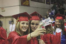 """<div class=""""source"""">Photo by John Overby</div><div class=""""image-desc"""">Courtney Edwards (left) and Cheyenne Lemay take a selfie of their own after graduation.</div><div class=""""buy-pic""""><a href=""""/photo_select/16513"""">Buy this photo</a></div>"""
