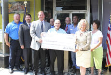"""<div class=""""source"""">Photo by Brandon Mattingly</div><div class=""""image-desc"""">Above, city and county officials come together for the presentation of CDBG funding for renovations of the Robertson building. They're joined by DLG Commissioner Tony Wilder, third from left, and AU Associates President Holly Wiedemann, second from right.</div><div class=""""buy-pic""""><a href=""""http://web2.lcni5.com/cgi-bin/c2newbuyphoto.cgi?pub=023&orig=img_4690.jpg"""" target=""""_new"""">Buy this photo</a></div>"""