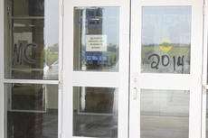 """<div class=""""source"""">Photo by Brandon Mattingly</div><div class=""""image-desc"""">""""MC"""" and """"2014"""" were spray painted throughout the building, including the front entrance.</div><div class=""""buy-pic""""><a href=""""/photo_select/17023"""">Buy this photo</a></div>"""