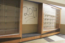 """<div class=""""source"""">Photo by Brandon Mattingly</div><div class=""""image-desc"""">Pictured is graffiti on the trophy case at the new school.</div><div class=""""buy-pic""""><a href=""""/photo_select/17024"""">Buy this photo</a></div>"""