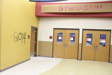 """<div class=""""source"""">Photo by Brandon Mattingly</div><div class=""""image-desc"""">Graffiti can be seen outside the facility's gymnasium, though the gym itself was left untouched.</div><div class=""""buy-pic""""><a href=""""/photo_select/17022"""">Buy this photo</a></div>"""