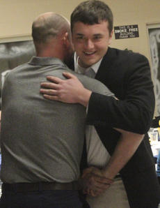 "<div class=""source"">Photo by John Overby</div><div class=""image-desc"">Seth Robinson (right) received the honor for Young Leader of the Year. He is shown here hugging his presenter, Ryan New.</div><div class=""buy-pic""><a href=""/photo_select/15736"">Buy this photo</a></div>"