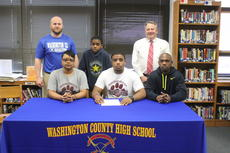 """<div class=""""source"""">Photo by John Overby</div><div class=""""image-desc"""">Morgan Churchill (front center) signed with the Campbellsville Tigers last week. He is the third WC football player to commit to the Tigers this year. </div><div class=""""buy-pic""""><a href=""""http://web2.lcni5.com/cgi-bin/c2newbuyphoto.cgi?pub=023&orig=img_9224_0.jpg"""" target=""""_new"""">Buy this photo</a></div>"""