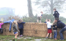 """<div class=""""source"""">Photo by Brandon Mattingly</div><div class=""""image-desc"""">The young field trippers raced to be the first to try out the hay bales at the Osbourne farm last Thursday.</div><div class=""""buy-pic""""><a href=""""http://web2.lcni5.com/cgi-bin/c2newbuyphoto.cgi?pub=023&orig=img_9450.jpg"""" target=""""_new"""">Buy this photo</a></div>"""