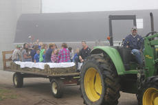 """<div class=""""source"""">Photo by Brandon Mattingly</div><div class=""""image-desc"""">James Sidney Osbourne brought the hay ride around after taking one of the classes on a tour of the farm.</div><div class=""""buy-pic""""><a href=""""http://web2.lcni5.com/cgi-bin/c2newbuyphoto.cgi?pub=023&orig=img_9474.jpg"""" target=""""_new"""">Buy this photo</a></div>"""