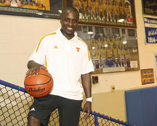 """<div class=""""source"""">Photo by Jeff Moreland</div><div class=""""image-desc"""">Washington County native J.T. Burton worked his way up the ladder from playing at WCHS and St. Catharine College to coaching at SCC. Now, Burton has been named director of player development for the University of Tennessee men's basketball team, where he will work under new head coach Donnie Tyndall, who coached Burton when he played at St. Catharine. Above, Burton poses in the WCHS gym with a photo of his 2004-05 5th Region championship team.</div><div class=""""buy-pic""""><a href=""""/photo_select/16472"""">Buy this photo</a></div>"""