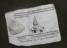 """<div class=""""source"""">Photo by Brandon Mattingly</div><div class=""""image-desc"""">Pictured above is one of the fliers that was left in a driveway in Mackville, along with the small, white stone that was included in the package.</div><div class=""""buy-pic""""><a href=""""http://web2.lcni5.com/cgi-bin/c2newbuyphoto.cgi?pub=023&orig=kkk_flier.jpg"""" target=""""_new"""">Buy this photo</a></div>"""