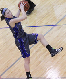 """<div class=""""source"""">Photo by John Overby</div><div class=""""image-desc"""">Sophomore Lexi Thompson catches a pass as the Commanderettes break Adair County's full-court press.</div><div class=""""buy-pic""""><a href=""""/photo_select/15764"""">Buy this photo</a></div>"""