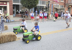 "<div class=""source"">Photo by Brandon Mattingly</div><div class=""image-desc"">Luke Vandenbroek and Andrew Wilson raced to the finish line during the Bring it to the Barn tractor races at the Kentucky Crossroads Harvest Festival on Saturday.</div><div class=""buy-pic""><a href=""/photo_select/15108"">Buy this photo</a></div>"