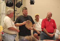"<div class=""source"">Photo by Brandon Mattingly</div><div class=""image-desc"">Chad Hayden of Taylorsville accepted the Hall of Fame induction of the Moonswiners, the two-time champion team made up of Hayden and his wife, Chris. The induction was presented by Ralph Blandford, far left, and Jim Beam Master Distiller Fred Noe, far right.</div><div class=""buy-pic""><a href=""/photo_select/15103"">Buy this photo</a></div>"