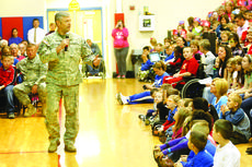 "<div class=""source"">Jesse Osbourne</div><div class=""image-desc"">Eric Mattingly spoke to North Washington Elementary School students on Friday to celebrate Veterans Day. Several schools, churches and organizations honored veterans throughout the week and the weekend. </div><div class=""buy-pic""><a href=""/photo_select/13327"">Buy this photo</a></div>"