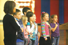 "<div class=""source"">Jesse Osbourne</div><div class=""image-desc"">North Washington Elementary School students recited the Pledge of Allegiance to begin the Veterans Day program on Friday.</div><div class=""buy-pic""><a href=""/photo_select/13332"">Buy this photo</a></div>"