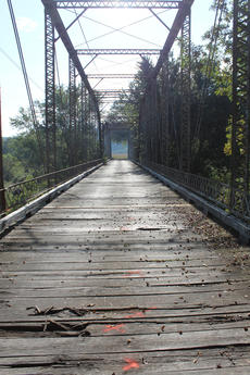 """<div class=""""source"""">Randy Patrick/Landmark News Service</div><div class=""""image-desc"""">The Old Fredericktown Road Bridge's wooden deck was replaced in 2006, and is now badly rotted again. Jim Lemieux, Nelson County's road superviser, said he counted 27 boards that need replacing and marked them in red.</div><div class=""""buy-pic""""><a href=""""http://web2.lcni5.com/cgi-bin/c2newbuyphoto.cgi?pub=023&orig=old_bridge_vertical.jpg"""" target=""""_new"""">Buy this photo</a></div>"""