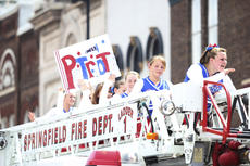 "<div class=""source"">Photo by Brandon Mattingly</div><div class=""image-desc"">The North Washington School cheer team caught a ride on a Springfield Fire Department engine during this past weekend's parade.</div><div class=""buy-pic""><a href=""/photo_select/15107"">Buy this photo</a></div>"