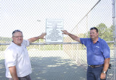 "<div class=""source"">Photo by Brandon Mattingly</div><div class=""image-desc"">Settles and Road Supervisor Dale Mann post a sign near the playground at the park showing appreciation to those who made the latest upgrades possible.</div><div class=""buy-pic""><a href=""/photo_select/16742"">Buy this photo</a></div>"
