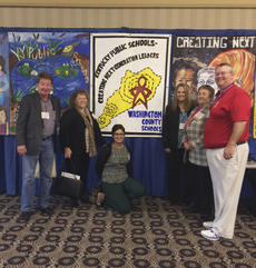 "<div class=""source"">Photo submitted</div><div class=""image-desc"">Washington County School officials stand in front of the banner that was created by Mirelle Taylor and other Washington County students for the Kentucky School Boards Association Conference earlier this month. From left, board members Pat Clements, Nora Hatton and Julita Nance, Superintendent Robin Cochran, Board Chair Patsy Lester and board member Curtis Hamilton.</div><div class=""buy-pic""></div>"