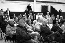 """<div class=""""source"""">Jesse Osbourne</div><div class=""""image-desc"""">Community members and elected officials gathered at a meeting with people from the postal service on Thursday at the Mackville Community Center.  </div><div class=""""buy-pic""""><a href=""""/photo_select/10062"""">Buy this photo</a></div>"""
