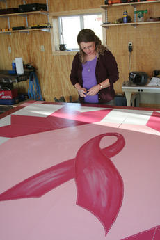 "<div class=""source"">Jeff Moreland</div><div class=""image-desc"">Washington County Community Health Educator Debra Galloway signed the border of a breast cancer barn quilt that was hung at the home of Barbara Hale Wheatley Monday morning. </div><div class=""buy-pic""><a href=""/photo_select/2252"">Buy this photo</a></div>"