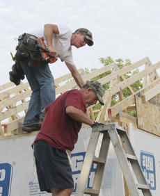 """<div class=""""source"""">Randy Patrick/Landmark News Service</div><div class=""""image-desc"""">Danny Raisor, left, and Doug Winchester work on the roof of the Kimberly Phillips house on McGowan.</div><div class=""""buy-pic""""><a href=""""/photo_select/16778"""">Buy this photo</a></div>"""