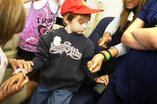 """<div class=""""source"""">Jesse Osbourne</div><div class=""""image-desc"""">Randall Chesser, the seven-year-old boy who went missing for nearly two days in Willisburg, learned about his new Project Lifesaver bracelet on Friday at Washington County EMS headquarters. The bracelet would help locate Chesser, who is autistic, if he were ever to go missing again.  </div><div class=""""buy-pic""""><a href=""""http://web2.lcni5.com/cgi-bin/c2newbuyphoto.cgi?pub=023&orig=randall.jpg"""" target=""""_new"""">Buy this photo</a></div>"""