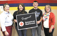 "<div class=""source"">Photo by John Overby</div><div class=""image-desc"">Pictured from left are American Red Cross Chapter Executive Director Susan Hardin, senior Chelsea Curtsinger, sophomore Morrison Smith and Lisa Haydon, a Washington County representative of the Red Cross.</div><div class=""buy-pic""><a href=""/photo_select/16321"">Buy this photo</a></div>"
