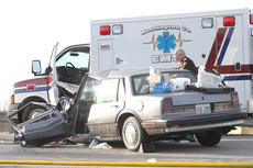 """<div class=""""source"""">Jesse Osbourne</div><div class=""""image-desc"""">Washington County Sheriff's Deputy Jackie Robinson surveyed the scene of a head-on collision on Hwy. 55 near Country Place on Tuesday. Three victims were transported to the hospital via ambulance after a head-on collision. Traffic backed up, as the wreck blocked the roadway.</div><div class=""""buy-pic""""></div>"""
