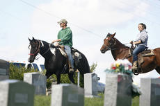 """<div class=""""source"""">Jesse Osbourne</div><div class=""""image-desc"""">Volunteers emerged on horseback after the search was completed on Monday in Willisburg. </div><div class=""""buy-pic""""><a href=""""http://web2.lcni5.com/cgi-bin/c2newbuyphoto.cgi?pub=023&orig=rescuers.jpg"""" target=""""_new"""">Buy this photo</a></div>"""
