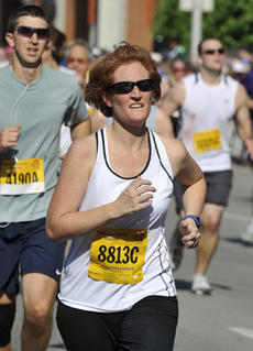"""<div class=""""source"""">Submitted</div><div class=""""image-desc"""">Kim Harmon ran in the Kentucky Derby Festival miniMarathon recently in Louisville. Harmon ran to raise money to benefit autism research.</div><div class=""""buy-pic""""><a href=""""http://web2.lcni5.com/cgi-bin/c2newbuyphoto.cgi?pub=023&orig=run-a.jpg"""" target=""""_new"""">Buy this photo</a></div>"""