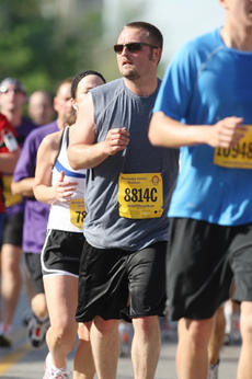 """<div class=""""source"""">Submitted</div><div class=""""image-desc"""">James Staser (8814C) ran in the Kentucky Derby Festival miniMarathon April 25 in Louisville. Staser's nephew, John Harmon, has autism, and Staser was running along with John's mother, Kim Harmon. Together, the two raised more than $700.</div><div class=""""buy-pic""""><a href=""""http://web2.lcni5.com/cgi-bin/c2newbuyphoto.cgi?pub=023&orig=run-b.jpg"""" target=""""_new"""">Buy this photo</a></div>"""