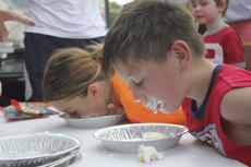 "<div class=""source"">Photo by Brandon Mattingly</div><div class=""image-desc"">Cousins Savanna Riley, 10, and James Riley, 7, went head-to-head in the pie contest on Saturday, as they attempted to fish out as much candy corn as they could without using their hands.</div><div class=""buy-pic""><a href=""/photo_select/15110"">Buy this photo</a></div>"