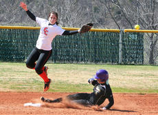 """<div class=""""source"""">Jesse Osbourne</div><div class=""""image-desc"""">Erika Adwell, a sophomore from Pleasure Ridge Park High school, slides safely into second in Saturday's first game.</div><div class=""""buy-pic""""><a href=""""/photo_select/8249"""">Buy this photo</a></div>"""