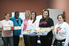 "<div class=""source"">SCC Communications</div><div class=""image-desc"">Several St. Catharine students helped out in the kitchen and served lunch during the Christmas Bazaar at the old Louisville Store. Pictured are, from left, Frances Nahale, Shanice Rogers, Sylvia Horlander, Laura Terrell, Brittany Smith and Kaitlyn Smith.</div><div class=""buy-pic""></div>"