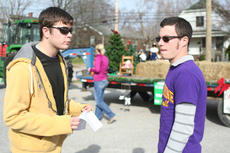 "<div class=""source"">SCC Communications</div><div class=""image-desc"">SCC students Niklas Walsh, left, and Travis Lyons organized participants in the Christmas parade in the parking lot of Washington County Industries.</div><div class=""buy-pic""></div>"