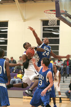 """<div class=""""source"""">Jimmie Earls</div><div class=""""image-desc"""">The Patriots' Kevin Owens flies past Berea's Chase Wofford as SCC defeated Berea 67-62 Thursday night.</div><div class=""""buy-pic""""><a href=""""/photo_select/4239"""">Buy this photo</a></div>"""