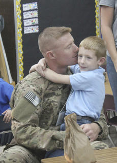 "<div class=""source"">Sun File Photo</div><div class=""image-desc"">Jason Shouse kissed his son, Hayden, after surprising him at St. Dominic School with his return from a year-long deployment in Afghanistan. </div><div class=""buy-pic""><a href=""/photo_select/15599"">Buy this photo</a></div>"