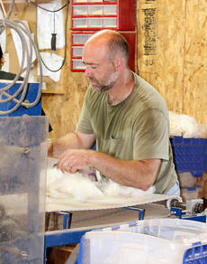 """<div class=""""source"""">Jeff Moreland</div><div class=""""image-desc"""">Shawn Malloy of Flaggy Meadow Fiber Works demonstrates a machine preparing alpaca fiber to be made into one of the many products the Malloys create.</div><div class=""""buy-pic""""><a href=""""/photo_select/8979"""">Buy this photo</a></div>"""