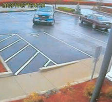 "<div class=""source"">Surveillance video image</div><div class=""image-desc"">Springfield State Bank surveillance video shows the suspect's vehicle, a 1998 maroon Buick Park Avenue, leaving the scene.</div><div class=""buy-pic""><a href=""/photo_select/3585"">Buy this photo</a></div>"