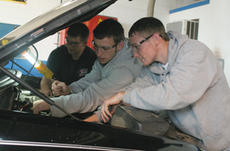"""<div class=""""source"""">Jeff Moreland</div><div class=""""image-desc"""">WCHS students Brian Bradshaw, Aaron Spalding and Johnathan Maupin look under the hood of a vehicle as part of the automotive program at the MCATC.</div><div class=""""buy-pic""""><a href=""""/photo_select/254"""">Buy this photo</a></div>"""