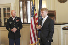 """<div class=""""source"""">Photo by Brandon Mattingly</div><div class=""""image-desc"""">Thomas Riney, right, explains his decision to join the U.S. Army to family and friends at the 1816 Courthouse building as Tim Cocanougher looks on.</div><div class=""""buy-pic""""><a href=""""http://web2.lcni5.com/cgi-bin/c2newbuyphoto.cgi?pub=023&orig=thomas1.jpg"""" target=""""_new"""">Buy this photo</a></div>"""